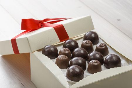 confectionery: assorted chocolates confectionery on wooden table