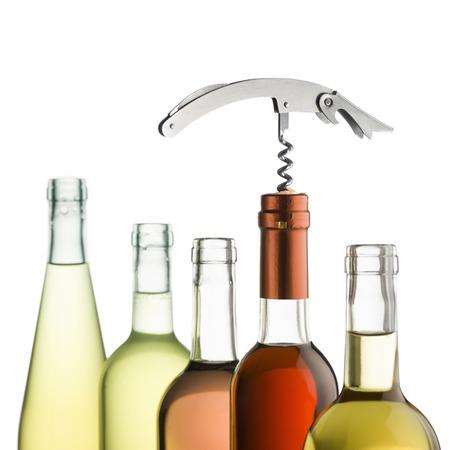 inserted: corkscrew inserted on wine bottles on white background