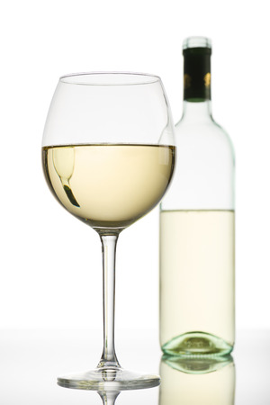 white wine: goblet with white wine and bottle on background Stock Photo
