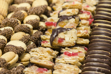 sweet pastry: variety of decorated sweet pastry with chocolate and almonds