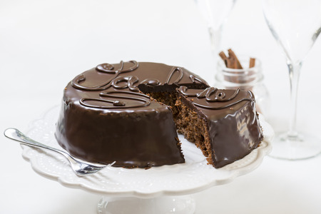 traditional sacher cake sliced on white plate