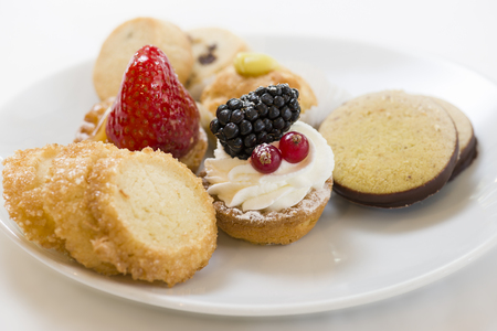 sweet pastry: variety of decorated sweet pastry on plate Stock Photo