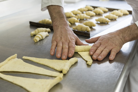 pastry chef: pastry chef shapes the dough with your hands for cookies