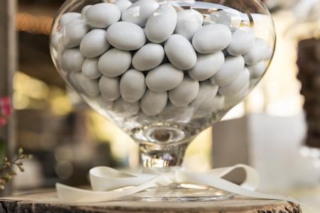 white sugared almond in glass jar
