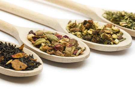 variety of tea blend on wooden spoon on white background Stock Photo