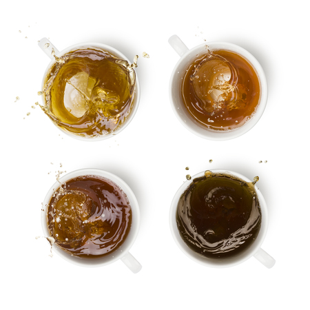 four different kind of tea into cup with splashing, on white background