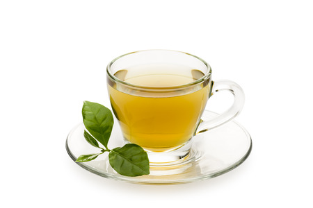 tea in glass cup with leaves, on white background Stock Photo