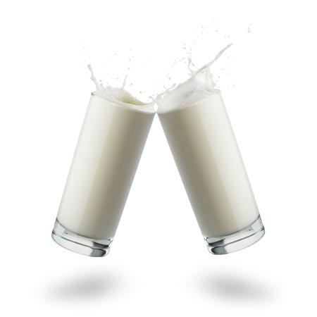 glasses full of milk jumping and splashing on white background.