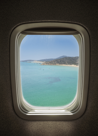 sunny sea landscape seen from window airplane. Stock Photo