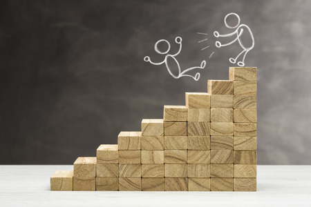 Concept of competition. Graphic with wooden steps on grey background and people shapes fight.