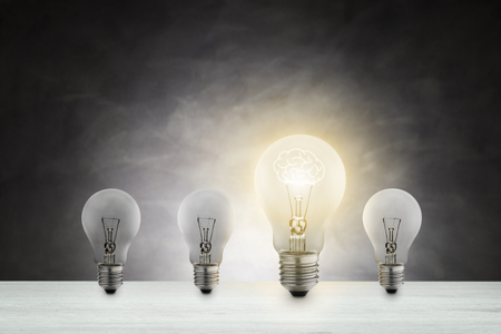 Concept of idea. light bulb lit with a brain-shaped filament