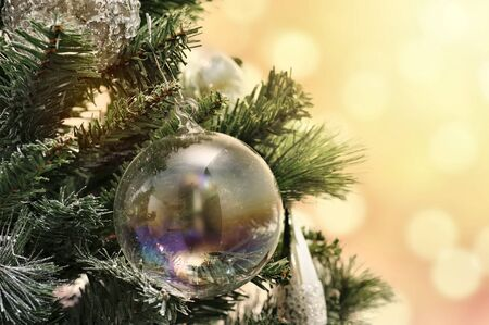 Christmas tree decorations on pine with light on background Stock Photo