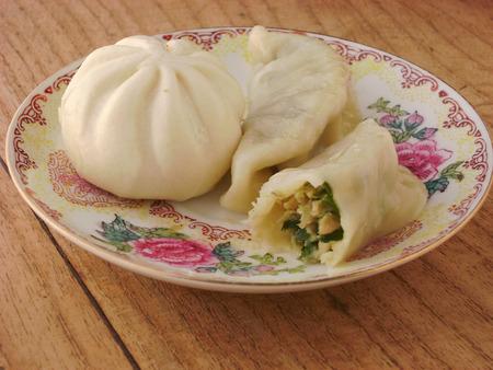 matzoh balls: Eating Chinese steamed meat ravioli dish. Stock Photo