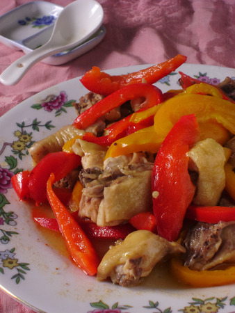 main course: Free range hen stir fried with red and yellow bell peppers. Chinese poultry main course.