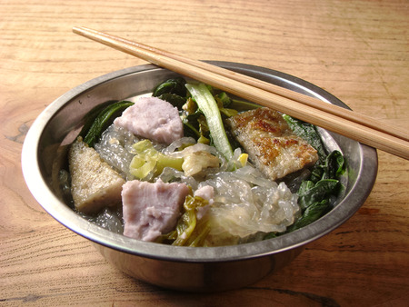 stiring: Noodles cooked with leftovers  ingredients, vegetable, fish fillet and taro. Stock Photo