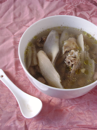 chinese yam: Double stewed fish soup with Chinese yam in bowl. Stock Photo