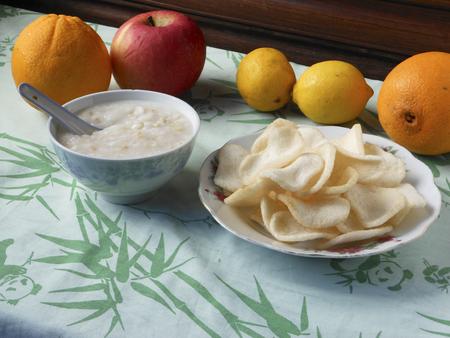 comfort food: A bowl of porridge beside a plate of crackers