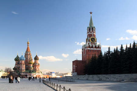 spasskaya: View of St. Basil the Blessed Cathedral and Kremlins Spasskaya tower. Red Square, Moscow. Russia. Stock Photo