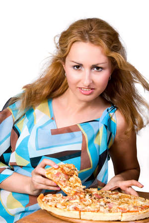 Young cheerful girl with piece of pizza. photo