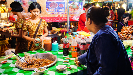 Kanchanaburi, Thailand - December 31, 2016: People it trading at Sangkhlaburi street market which is very famous with Mon ethnic group, Thailand in the night time of December 2016