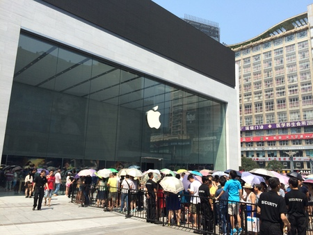 Crowd gathering outside of an Apple Store