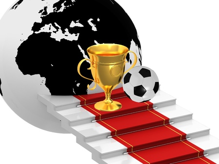 Cups with soccer ball on the ladders with red carpet photo