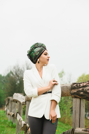 portrait of a girl with a scarf on her head in nature