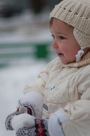 poppet: Little girl with snowball Stock Photo