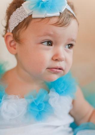 poppet: Little girl in blue dress Stock Photo