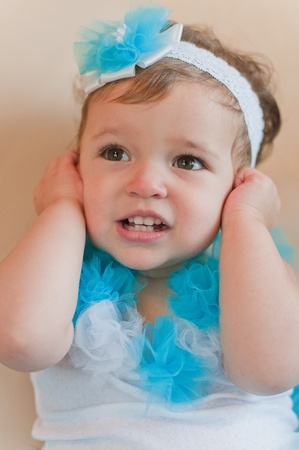 poppet: Little girl closes her ears