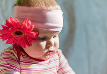 Baby in the headband with gerbera flower Stock Photo - 12544618