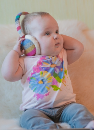 Portrait of baby in t-shirt with headphones photo