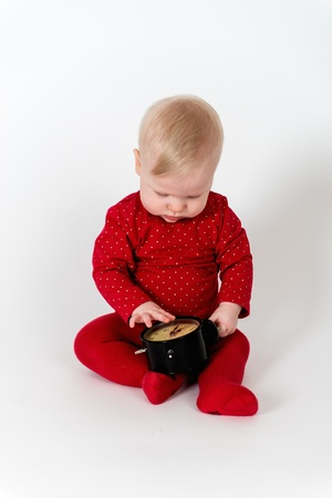 8 9 months: Little girl with clock