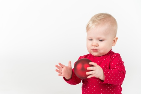 6 9 months: Little girl with red ball Stock Photo