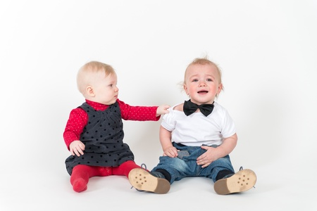 6 9 months: Two sitting kids on the white background