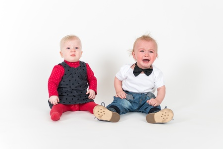 Two sitting kids on the white background photo