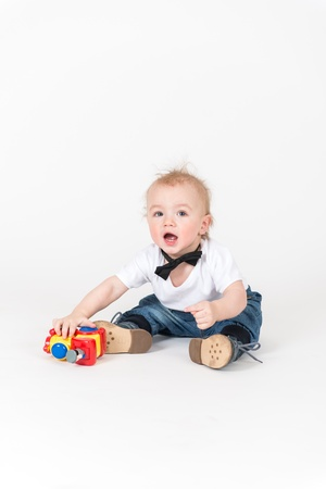 8 9 months: Little boy sits with the train toy
