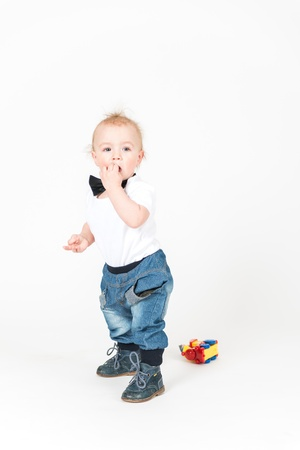 6 9 months: Little boy stays on the white background Stock Photo