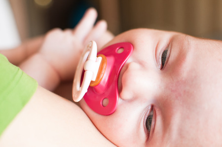 nipple girl: Portrait of the baby with red nipple Stock Photo