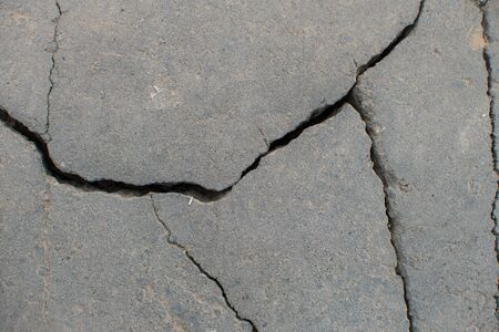 Cracked asphalt on the road. Background texture for design and modeling Фото со стока