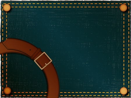 Brown belt with a metal plate located on a abstract background made of a jeans fabric photo