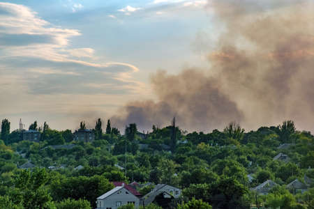 Smoke from a summer fire on the outskirts of the city