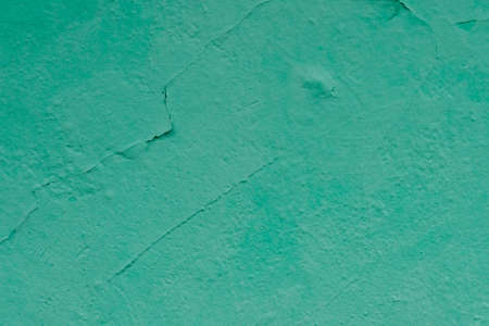 Wall with cracked paint mint color. Stock Photo