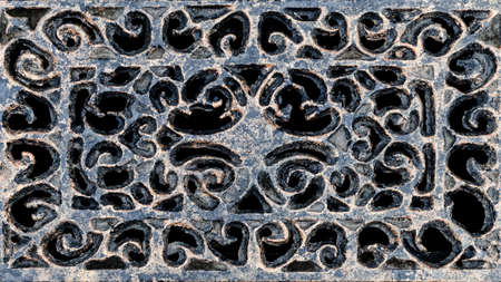 Old, vintage metal background from openwork wrought iron. Grate for wastewater.