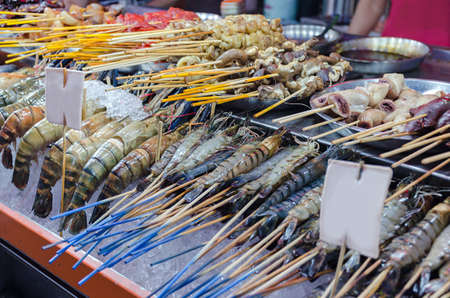 Stall with fresh chilled shrimps, seafood. Food Street Jalan Alor - in Kuala Lumpur, Malaysia.