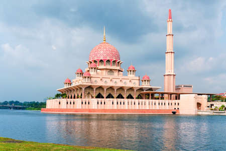 General view of the Putra Mosque with Putrajaya Lake, day with dramatic sky. Editorial