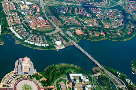Overhead city view - Prime Ministers Department Complex, Federal Government Administrative Centre - Jabatan Perdana Menteri,  Putra Mosque with Putra lake. Aerial cityscape of Malaysia.