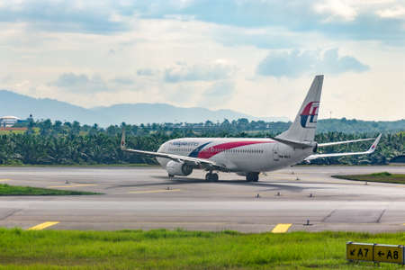Malaysia, KLIA -2: 2018-03-05: Airplane Malaysia airline taxiing to the runway at airport.