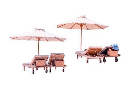 Wooden beach chairs with umbrellas isolated on white background. Beach sun lounger isolated.