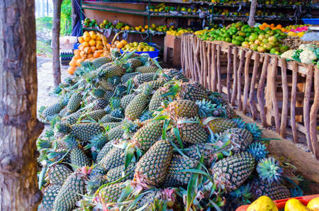Fruit market in Sri Lanka. Fresh pineapples and other tropical fruits on the street market in Asia.